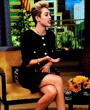Miley Cyrus cleaned up well in a black Chanel skirt suit with pearl buttons for an appearance at a talk show.