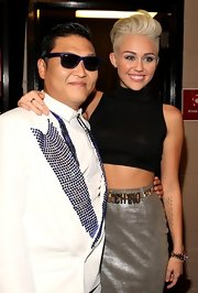 Miley Cyrus styled her outfit with a leopard-print belt by Moschino.