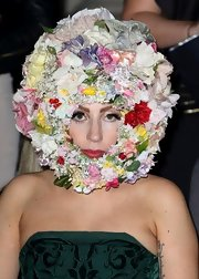 Lady Gaga totally stole the spotlight with her Philip Treacy floral headpiece during London Fashion Week.