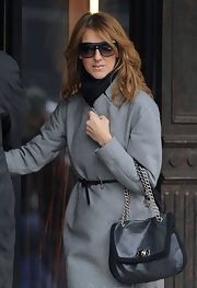 Celine Dion carried a stylish black chain-strap bag while visiting the salon.