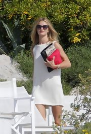 Rosie Huntington-Whiteley kept it laid-back in a sleeveless white knit dress while vacationing in France.