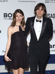 Sofia Coppola complemented her dress with a pleated black satin clutch.