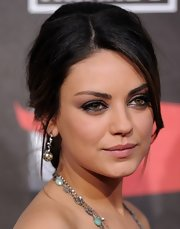 Mila Kunis finished off her look with a pair of diamond spheres by Ofira.