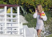 Rosie Huntington-Whiteley hit the beach wearing a cute white crochet cover-up.