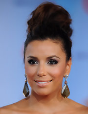 Eva Longoria complemented her updo with a huge pair of gemstone teardrop earrings.