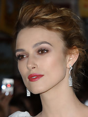 Keira Knightley polished off her look with a pair of dangling diamond earrings by Van Cleef & Arpels.