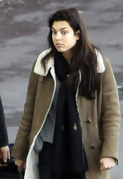 Charlotte Casiraghi took a flight out of Nice Côte d'Azur Airport wearing an embroidered black scarf and a tan suede jacket.