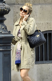 Kate Hudson took a stroll in Paris wearing a khaki trenchcoat.