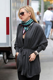 Kate Hudson looked stylish on the set of 'Something Borrowed' wearing a printed scarf with a belted gray cardigan.
