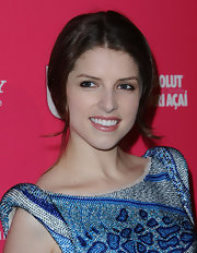 Anna Kendrick pulled her tresses back into a center-parted chignon for the Us Weekly Hot Hollywood event.