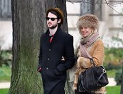 Sienna Miller looked posh wearing this fur hat while out on a stroll.