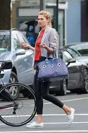 Jessica Hart made sure her dog traveled in style in a Goyard duffle.