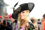 Pixie Lott attended Ladies Day wearing a bouquet-adorned black hat.