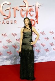 Famke Janssen attended the red carpet premiere of 'Hansel and Gretel' wearing a beautiful sequined fur gown.