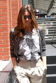 Jessica Biel layered a beaded gray Oscar de la Renta cardigan over her ruffle blouse for an even chicer finish.