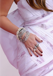 For her mani, Miley Cyrus chose a metallic red hue.