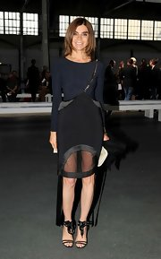 Carine Roitfeld attended the Givenchy Menswear fashion show wearing a leotard-style black sweater.
