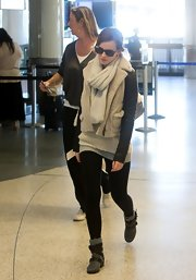 Emma Watson bundled up in edgy style with a leather-sleeve shearling jacket by Yigal Azrouel for a flight out of LA.
