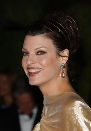 Linda Evangelista had her hair braided and tied up to match her floor-length gown at the Vanity Fair party.