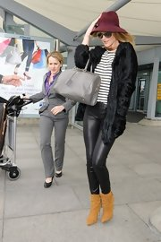 Rosie Huntington-Whiteley brought a dose of luxe glamour to Heathrow Airport with this black fur coat.