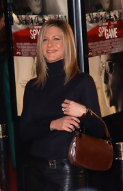 Jennifer Aniston arrived for the premiere of 'Spy Game' carrying a classic brown satchel.