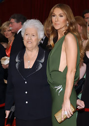 Celine Dion paired an elegant gold clutch with a green gown for the 2007 Oscars.
