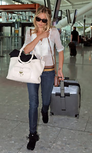 Sienna Miller's arm candy for the day was a stylish white leather tote by Jimmy Choo.
