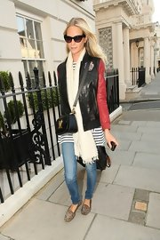 For her footwear, Poppy Delevingne chose a pair of studded leopard-print smoking slippers.