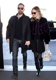 Kate Bosworth's black and purple fur jacket was a luxurious take on the bomber jacket.