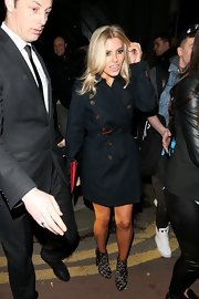 Mollie King styled her coat with a pair of leopard-print ankle boots by Topshop.