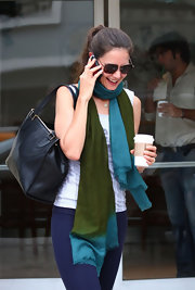 Katie Holmes dressed up her casual look with a color-block scarf for a coffee run.