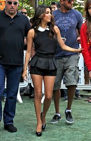 Eva Longoria amped up the cuteness with a pair of black peplum shorts.