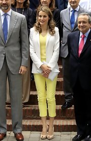 Princess Letizia looked vibrant in yellow capris, a matching shirt, and a white blazer while visiting student dormitories in Madrid.