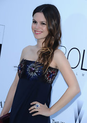 Rachel Bilson attended the amfAR party wearing a beautiful Chanel Camelia ring.