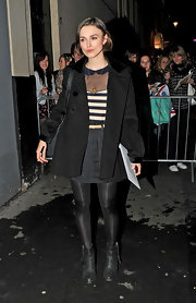 Keira Knightley looked cute in a black pea coat layered over a striped top as she left the Comedy Theater.