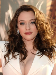 Kat Dennings glammed up her look with a pair of four-leaf shamrock diamond studs.
