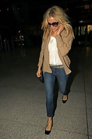 Sienna Miller teamed her cardigan with casual-chic cropped jeans by J Brand.