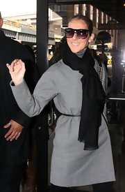 Celine Dion headed to the salon looking stylish in her scarf and coat combo.