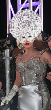 Lady Gaga amped up the glam factor with this crystal headpiece and corset gown combo by Atelier Versace while dropping the New Year's Eve Ball.