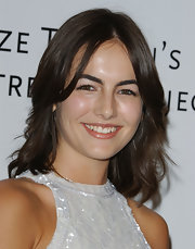 Camilla Belle sported feathery, center-parted waves at the Amped for Africa event.
