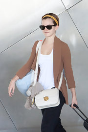 Emma Watson was spotted at LAX carrying a stylish white leather bag.