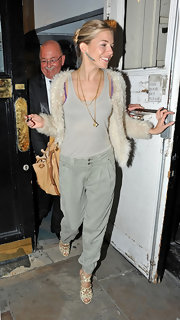 Sienna Miller balanced out her sexy top with a pair of tomboy-chic jeans.