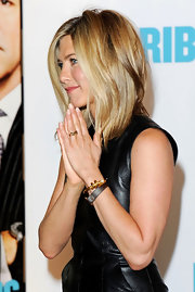 Jennifer Aniston matched her LBD with a black leather bracelet at the 'Horrible Bosses' photocall.