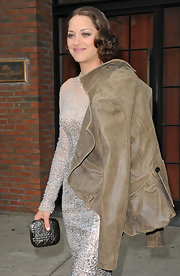 Marion Cotillard went for total shimmer with this metallic minaudiere and sequined gown combo.