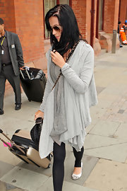 Katy Perry stayed comfy in a pair of ballet flats while traveling from London to Paris.