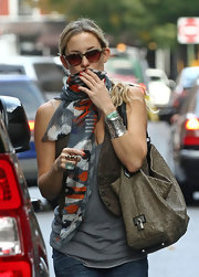 Kate Hudson styled her casual outfit with a printed silk scarf for a day out.