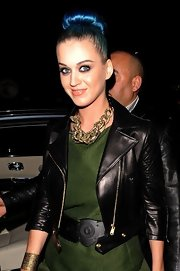 Katy Perry glitzed up her outfit with a chunky gold chain necklace for the YSL Fall 2012 show.