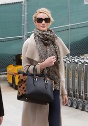 Rosie Huntington-Whiteley sported a pair of oversized square sunnies while catching a flight at LAX.
