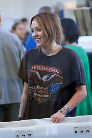 Miley Cyrus accessorized with a ton of silver and turquoise bracelets for a flight.