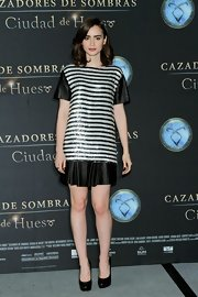 Lily Collins showed off her pins in a stripy Rachel Zoe mini dress at a photocall for 'The Mortal Instruments: City of Bones.'